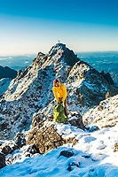 Eric Hanson on the summit of Mount Hikurangi (or Te Ara ki Hikurangi in Māori) is a 1,752 m (5,748 ft) peak in the eastern corner of New Zealand's North Island, about 80 kilometres (50 mi) north of Gisborne, and 50 kilometres (31 mi) southwest of the East Cape Lighthouse.[2] On a spur of the Raukumara Range in the Waiapu Valley, it is the North Island's highest non-volcanic peak. The peak is traditionally regarded as the first land in the world to catch the rays of the new day's sun, although this claim, like any such claim of its type, is open to interpretation. Certainly it is not true at any time of the year other than the Southern Hemisphere summer, as both Fiji and Tonga are to the east. In summer, however, because of the tilt of the Earth's axis, it does receive the sun's rays earlier than these places.[5] It does not receive them earlier than the Chatham Islands (or, of course, Antarctica), however. This did not stop the mountain gaining world prominence in the celebrations for the new Millennium. SOURCE - Wikipedia