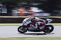 Max Neukirchner (GER) riding the Ducati Panigale 1199R (27) of the MR-Racing team rounds turn 11 during a practise session on day two of round one of the 2013 FIM World Superbike Championship at Phillip Island, Australia.
