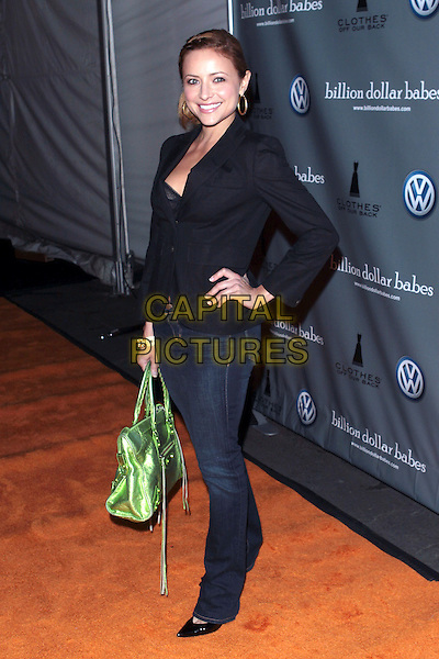 CHRISTINE LAKIN BillionDollarBabes.com LA Sale Opening Night  held at the The Petersen Automotive Museum, Los Angeles, California, USA, .5th November 2009..full length green bag black jacket hand on hip jeans Balenciaga  .CAP/ADM/TC.©T. Conrad/AdMedia/Capital Pictures.