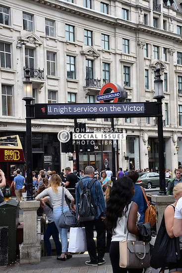 Oxford Circus underground station, London UK. Sign promoting the new all night service on the Victoria Line, August 2016