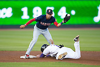 Salem Red Sox shortstop Mauricio Dubon (10) tries to catch a throw as Hunter Jones (29) of the Winston-Salem Dash slides head first into second base at BB&T Ballpark on April 15, 2016 in Winston-Salem, North Carolina.  The Red Sox defeated the Dash 3-2.  (Brian Westerholt/Four Seam Images)