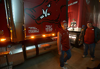 NWA Democrat-Gazette/ANDY SHUPE<br />Jerry Rico (left) of Fayetteville and Rodney Collins prepare a semi-truck Thursday, Nov. 9, 2017, before heading out to Baton Rouge, La., ahead of the Razorbacks' game with LSU Saturday. Rico and coworker Rodney Collins are employees of J.B. Hunt Transport and the work together to drive equipment necessary for the Razorbacks football team to and from games away from Fayetteville.