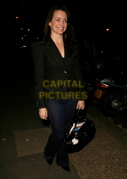 """KRISTIN DAVIS.Leaving Riverside Studios, Hammersmith, where she had been a guest performer in the play """"The Exonerated"""", London, England, May 2nd 2006..kristen full length jeans black jacket bag white heart.REf: AH.www.capitalpictures.com.sales@capitalpictures.com.©Adam Houghton/Capital Pictures."""