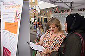 Consultation with local residents at a Neighbourhood Management stall at Church Street Summer Festival, London.