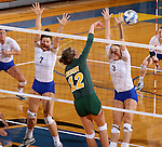 BROOKINGS, SD - SEPTEMBER 30:  Emily Miron #12 from North Dakota State  tries to get a kill past Tiara Gibson #7 and Kacey Herrmann #3 from South Dakota State in the second game of their match Tuesday night at Frost Arena in Brookings. (Photo/Dave Eggen/Inertia)
