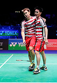 17th March 2018, Arena Birmingham, Birmingham, England; Yonex All England Open Badminton Championships; MarcusFernaldi Gideon (INA) and Kevin Sanjaya Sukamuljo (INA) hug each other after winning their semi-final match against Mads Conrad-Petersen (DEN) and Mads Pieler Kolding (DEN)
