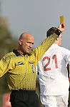 10 November 2007: Referee Peter Dhima issues a yellow card. The Duke University Blue Devils defeated the North Carolina State University Wolfpack 2-0 at Method Road Soccer Stadium in Raleigh, North Carolina in an Atlantic Coast Conference NCAA Division I Men's Soccer game.