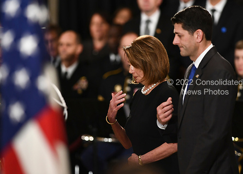 US House representatives Nancy Pelosi (D-CA) and speaker of the US House of Representatives Paul Ryan (R-WI) (R) pay their respects to former US President George H.W. Bush at the US Capitol during a State Funeral in Washington, DC, December 3, 2018. - The body of the late former President George H.W. Bush will travel from Houston to Washington, where he will lie in state at the US Capitol through Wednesday morning. Bush, who died on November 30, will return to Houston for his funeral on Thursday. (Photo by Brendan Smialowski / AFP)