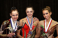 (L-R) Galina Shyrkina of Ukraine (2nd), Anna Bessonova of Ukraine (1st), Brenann Stacker of USA (3rd) are All-Around winners at San Francisco Invitational on February 11, 2006. (Photo by Tom Theobald)