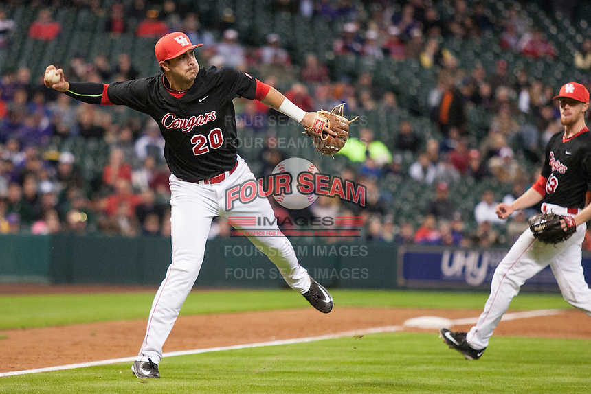 Houston Cougars third baseman Justin Montemayor (20) prepares to make a running throw during the NCAA baseball game against the LSU Tigers on March 6, 2015 at Minute Maid Park in Houston, Texas. LSU defeated Houston 4-2. (Andrew Woolley/Four Seam Images)
