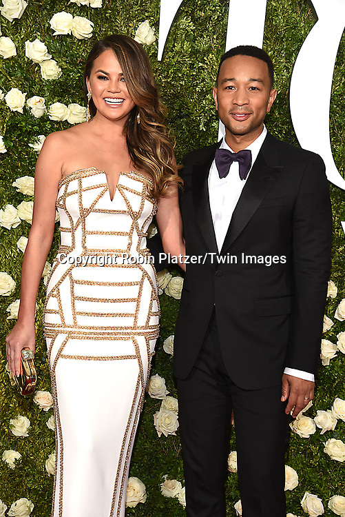 Chrissy Teigen and John Legend attend the 71st Annual  Tony Awards on June 11, 2017 at Radio City Music Hall in New York, New York, USA.<br /> <br /> photo by Robin Platzer/Twin Images<br />  <br /> phone number 212-935-0770