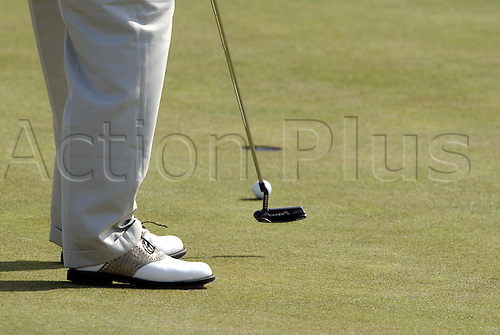 July 19, 2003: Detail view, from below the knees, of a golfer putting to the hole , The Open Championship, Royal St George's Golf Club Photo: Neil Tingle/Action Plus...British 2003 golf golfer golfers 030719 green greens putt putts ident idents detail details equipment holes