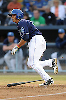 Asheville Tourists designated hitter Dillon Thomas #27 swings at a pitch during a game against the  Kannapolis Intimidators at McCormick Field on May 9, 2013 in Asheville, North Carolina. The Intimidators won the game 13-12. (Tony Farlow/Four Seam Images).