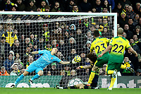 1st December 2019; Carrow Road, Norwich, Norfolk, England, English Premier League Football, Norwich versus Arsenal; Bernd Leno of Arsenal saves the shot from Kenny McLean of Norwich City - Strictly Editorial Use Only. No use with unauthorized audio, video, data, fixture lists, club/league logos or 'live' services. Online in-match use limited to 120 images, no video emulation. No use in betting, games or single club/league/player publications