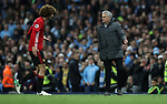 Jose Mourinho manager of Manchester United  and Marouane Fellaini of Manchester United react after he is sent off by referee Martin Atkinson during the English Premier League match at The Etihad Stadium, Manchester. Picture date: April 27th, 2016. Photo credit should read: Lynne Cameron/Sportimage