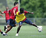 Eddie Johnson (r) plays the ball under pressure from Pablo Mastroeni (l) on Sunday, May 14th, 2006 at SAS Soccer Park in Cary, North Carolina. The United States Men's National Soccer Team held a training session as part of their preparations for the upcoming 2006 FIFA World Cup Finals being held in Germany.