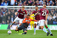 Martin Olsson of Swansea City is fouled by Birkir Bjarnason of Aston Villa during the Sky Bet Championship match between Aston Villa and Swansea City at Villa Park in Birmingham, England, UK.  Saturday 20 October  2018