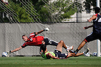 New York Red Bulls goalkeeper Greg Sutton (24) makes a save during a New York Red Bulls practice on the campus of Montclair State University in Upper Montclair, NJ, on July 16, 2010.