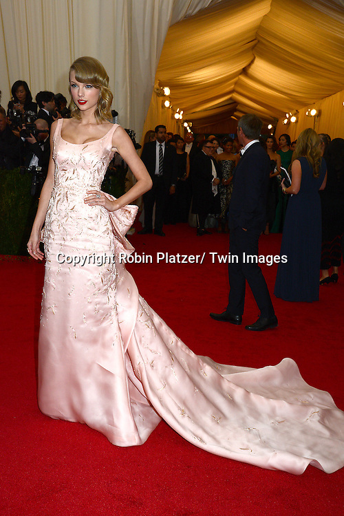 Taylor Swift attends the Costume Institute Benefit on May 5, 2014 at the Metropolitan Museum of Art in New York City, NY, USA. The gala celebrated the opening of Charles James: Beyond Fashion and the new Anna Wintour Costume Center.