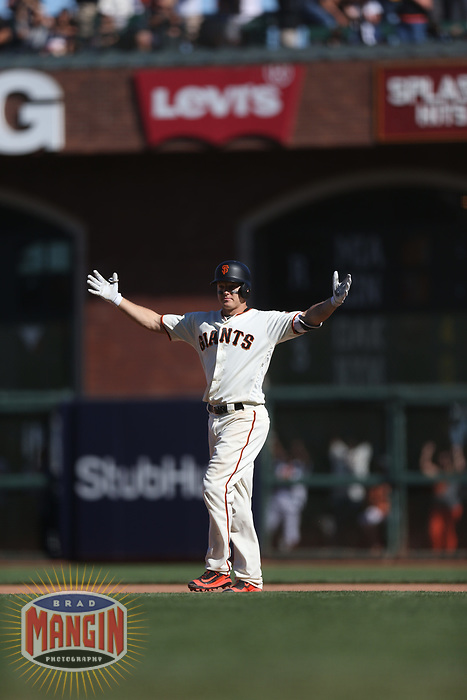 SAN FRANCISCO, CA - JULY 22:  Nick Hundley #5 of the San Francisco Giants celebrates his game-winning hit in the bottom of the 12th inning against the San Diego Padres during the game at AT&T Park on Saturday, July 22, 2017 in San Francisco, California. (Photo by Brad Mangin)