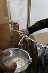 Israel, Bnei Brak. Passover at the Premishlan congregation, the Motzot baking on Passover eve, the Rabbi is pouring the water into the flour bowl, 2005<br />