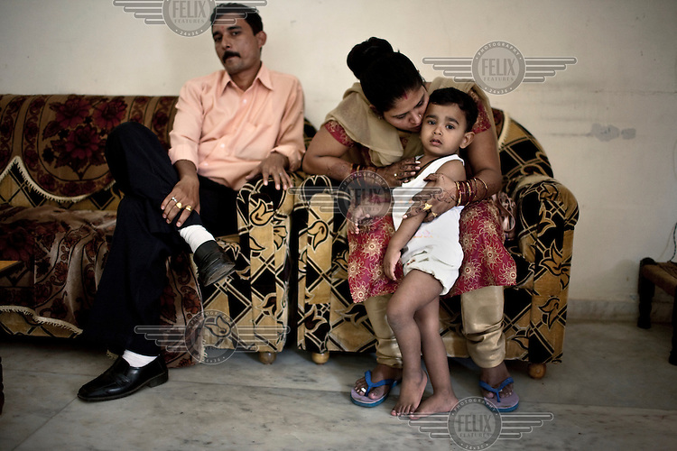 31 year old Rabina Mondal with her son Sahil, and husband Bishwadeep, at her home in Anand. She was the Akanksha Infertility and IVF Clinic's first surrogate mother for a western couple. The centre has become the most popular clinic in India for outsourcing pregnancies for western couples.