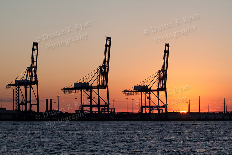 sunset charleston south carolina shipping container port cranes