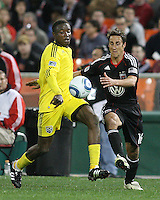 Josh Wolfe#16 of D.C. United goes for the ball with Emmanuel Ekpo#17 of the Columbus Crew during the opening match of the 2011 season at RFK Stadium, in Washington D.C. on March 19 2011.D.C. United won 3-1.