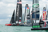 25 July 2015: Oracle Team USA gets an excellent start at the beginning of race 2 during the America's Cup first round racing off Portsmouth, England (Photo by Rob Munro)