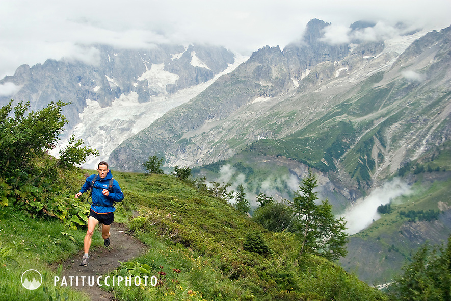 Topher Gaylord running through the Val Ferret in wet weather. Tour of Mont Blanc, Courmayeur, Italy