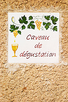 A sign showing the tasting room Caveau de degustation. Chateau Mourgues du Gres Grès, Costieres de Nimes, Bouches du Rhone, Provence, France, Europe