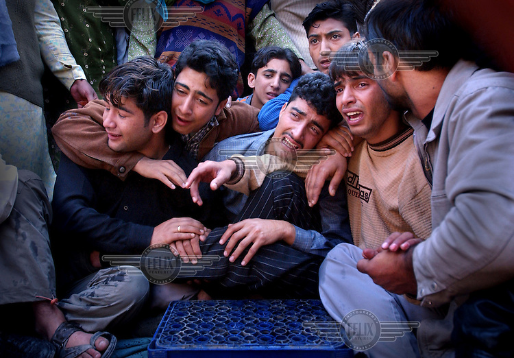 The relatives and neighbours of Muzzamil Ahmad, a 19 year old Muslim who was killed when he was hit by an Indian security force vehicle, mourn his death in Srinagar.