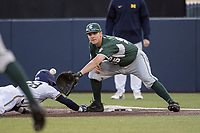 Michigan State Spartans first baseman Zack McGuire (55) reaches for a pick off attempt against the Michigan Wolverines during the NCAA baseball game on April 18, 2017 at Ray Fisher Stadium in Ann Arbor, Michigan. Michigan defeated Michigan State 12-4. (Andrew Woolley/Four Seam Images)