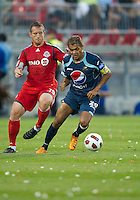 27 July 2010: Toronto FC forward Chad Barrett #19 and Club Deportivo Motagua midfielder Amado Guevara #20 in action during a CONCACAF Preliminary game between Club Deportivo Motagua and Toronto FC at BMO Field in Toronto..Toronto FC won 1-0....