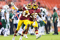 Landover, MD - August 16, 2018: Washington Redskins cornerback Prince Charles Iworah (47) and Washington Redskins cornerback Joshua Holsey (38) celebrate an interception during preseason game between the New York Jets and Washington Redskins at FedEx Field in Landover, MD. (Photo by Phillip Peters/Media Images International)