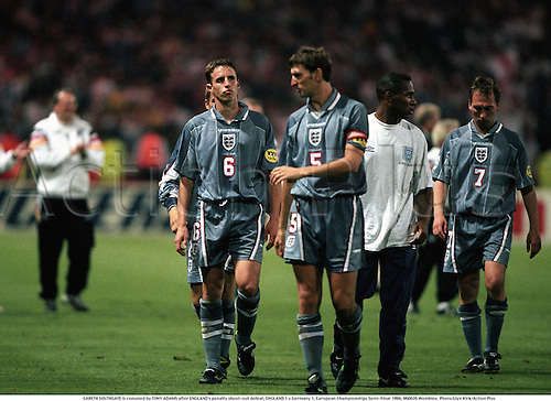 GARETH SOUTHGATE is consoled by TONY ADAMS after ENGLAND's penalty shoot-out defeat, ENGLAND 1 v Germany 1, European Championships Semi-Final 1996, 960626 Wembley. Photo:Glyn Kirk/Action Plus...football.Euro 96.soccer.disappointment disappointments.distress.disappointed.misery.sad sadness.losing loser.