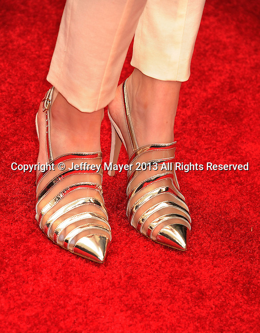 CULVER CITY, CA- APRIL 14:  Actress Bella Thorne (shoe detail) at the 2013 MTV Movie Awards at Sony Pictures Studios on April 14, 2013 in Culver City, California.