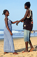 Gambia. Bakau. Atlantic ocean. Bakau is 15 km away from the capital Banjul. A young woman flirts with with a young man on the beach. © 2000 Didier Ruef