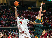 COLLEGE PARK, MD - FEBRUARY 13: Ashley Owusu #15 of Maryland and Monika Czinano #25 reach up for a loose ball during a game between Iowa and Maryland at Xfinity Center on February 13, 2020 in College Park, Maryland.