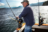 USA, Alaska, Ketchikan, Captain Tony tending to his lines while fishing the Behm Canal near Clarence Straight, Knudsen Cove along the Tongass Narrows