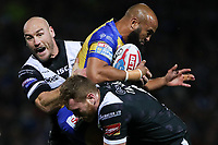 Picture by Alex Whitehead/SWpix.com - 29/09/2017 - Rugby League - Betfred Super League Semi-Final - Leeds Rhinos v Hull FC - Headingley Carnegie Stadium, Leeds, England - Leeds' Jamie Jones-Buchanan is tackled by Hull FC's Gareth Ellis and Scott Taylor.