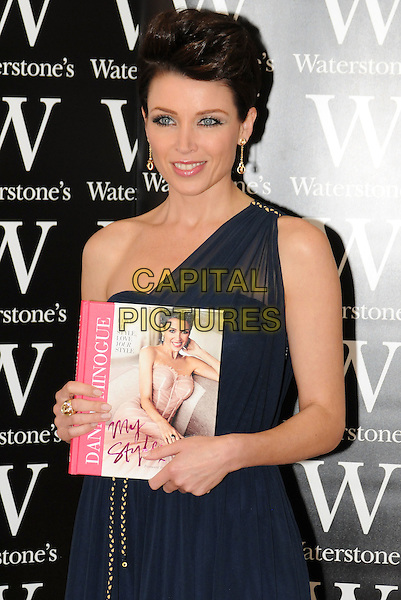 "Dannii Minogue signs copies of her new book ""My Style"" at Bluewater Shopping Centre, Greenhithe, Kent, England, UK..29th September 2011.half length black navy blue one shoulder dress .CAP/BRC.©Ben Rector/Capital Pictures."