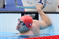 PICTURE BY ALEX BROADWAY /SWPIX.COM - 2012 London Paralympic Games - Day Seven - Swimming, Aquatic Centre, Olympic Park, London, England - 05/09/12 - James Anderson of Great Britain competes in the Men's 100m Backstroke S2 Final.