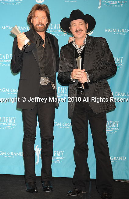 LAS VEGAS, NV. - April 18: Musicians Ronnie Dunn (L) and Kix Brooks of the band Brooks & Dunn, winners of the Top Vocal Duo Of The Year Award pose in the press room during the 45th Annual Academy of Country Music Awards at the MGM Grand Garden Arena on April 18, 2010 in Las Vegas, Nevada.