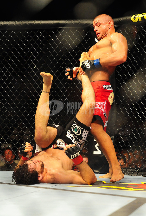 Aug. 7, 2010; Oakland, CA, USA; UFC fighter Thiago Alves (red shorts) against Jon Fitch during the welterweight bout in UFC 117 at the Oracle Arena. Mandatory Credit: Mark J. Rebilas
