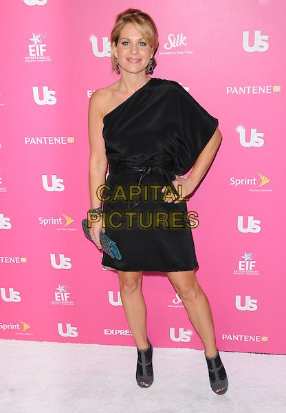 CANDACE CAMERON BURE.The Annual US Weekly Hot Hollywood Event held at The Colony in Hollywood, California, USA..November 18th, 2010.full length dress hand on hip clutch bag ankle boots grey gray peep toe black one shoulder .CAP/RKE/DVS.©DVS/RockinExposures/Capital Pictures.