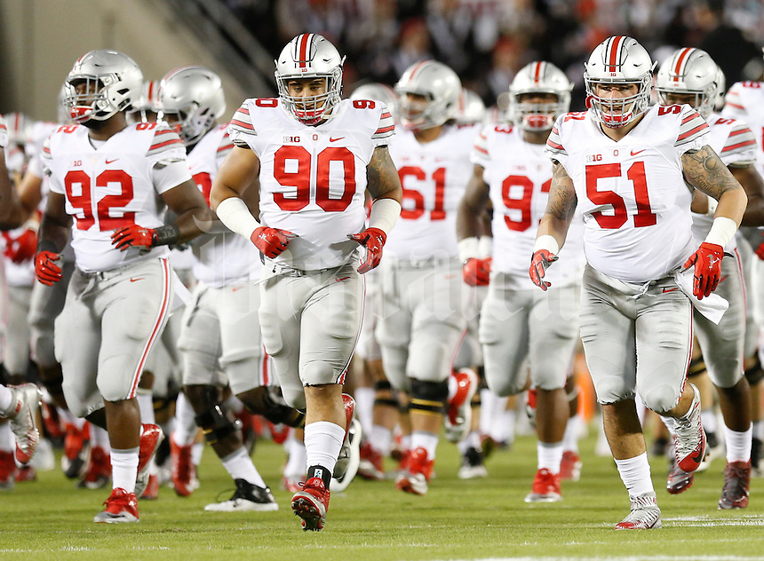 Ohio State Buckeyes linemen Adolphus Washington (92), Tommy Schutt (90) and Joel Hale (51) take the field for Monday's NCAA Division I football game against the Virginia Tech Hokies in Blacksburg, Va., on September 7, 2015. Ohio State won the game 42-24. (Dispatch Photo by Barbara J. Perenic)