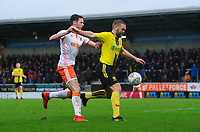 Burton Albion's Jake Buxton under pressure from Blackpool's Ben Heneghan<br /> <br /> Photographer Chris Vaughan/CameraSport<br /> <br /> The EFL Sky Bet League One - Burton Albion v Blackpool - Saturday 16th March 2019 - Pirelli Stadium - Burton upon Trent<br /> <br /> World Copyright &copy; 2019 CameraSport. All rights reserved. 43 Linden Ave. Countesthorpe. Leicester. England. LE8 5PG - Tel: +44 (0) 116 277 4147 - admin@camerasport.com - www.camerasport.com