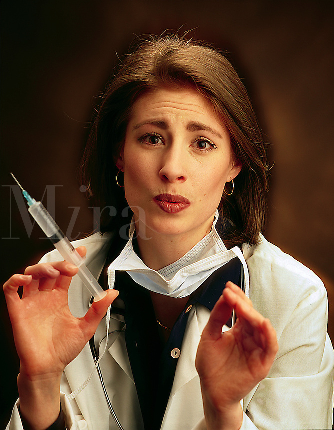 medical nurse with a large hypodermic needle. Medicine, expressions, woman, women, female, injection.