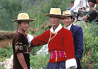 "21-year-old, Da Shi, center, with friends in traditional hats at the annual fertility festival dedicated to the God Ganmo. Men wear their best clothes in the hope of securing a partner. Women from the Mosuo tribe do not marry, take as many lovers as they wish and have no word for ""father"" or ""husband"". But the arrival of tourism and the sex industry is changing their culture...PHOTO BY SINOPIX"